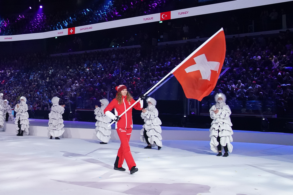 Thibe Deseyn SUI, the flag bearer for Switzerland SUI arriving during the Parade of NOC flags during the Opening Ceremony at the Lausanne Vaudoise Arena. The Winter Youth Olympic Games, Lausanne, Switzerland, Thursday 09 January 2020. Photo: OIS/Joe Toth. Handout image supplied by OIS/IOC.
